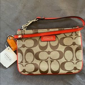 Coach wristlet with red orange leather